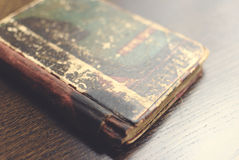 Old book. Damaged old book on table royalty free stock photo