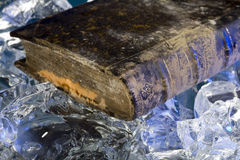 Old book damaged by water during floods on frozen ice Royalty Free Stock Photography