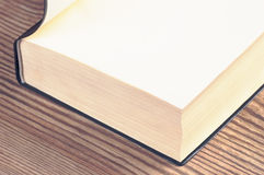 Old book edges and title page on old rustic wooden table Royalty Free Stock Photos