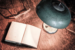 Old book and electric lamp Royalty Free Stock Images