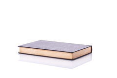 Old book with empty blank cover. Studio shot isolated on white Royalty Free Stock Photo