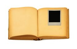 Old book with empty photo frame inside.  Stock Images