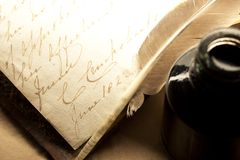 Old book with feather Stock Photography