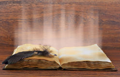 Open book with light royalty free stock photo