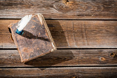 Old book and a fountain pen with ink Royalty Free Stock Photography