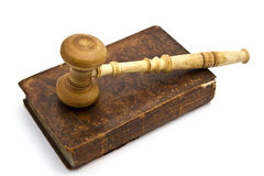 Old book and gavel Stock Images