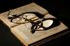 Old book with glasses Royalty Free Stock Photo