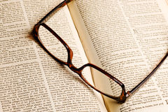 Old book with glasses Royalty Free Stock Photography