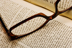 Old book with glasses Royalty Free Stock Photos