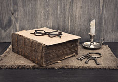 Old book, glasses and a bunch of keys Stock Images