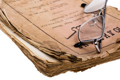 Old book with glasses close up Stock Image