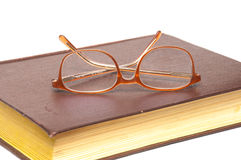 Old book and glasses isolated on white Royalty Free Stock Photography