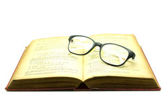 Old book and glasses isolated on white Royalty Free Stock Image