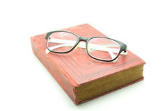 Old book and glasses isolated on white Stock Photo