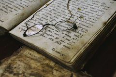 Old book and glasses Stock Images