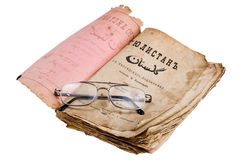 Old book with glasses on white Stock Photos