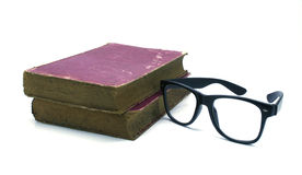 Old book and glasses on a white Stock Photo