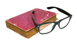 Old book and glasses Stock Photos