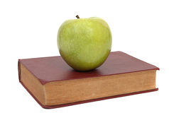 Old book and green apple Stock Image