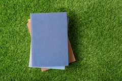 Old  book on green grass Stock Photo