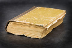 Old book on a grey background Royalty Free Stock Image