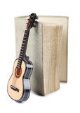 Old book and guitar Stock Image