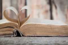 An old book with heart-shaped pages. Horizontal view stock photography