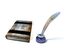 Old book and inkstand Stock Photography