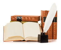 Old book with inkwell and quill pen Royalty Free Stock Photography
