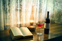 Old book and a kerosene lamp Royalty Free Stock Photos
