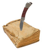 Old book and knife Royalty Free Stock Photography