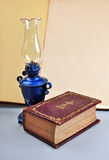 Old book and lamp royalty free stock images