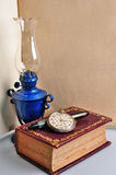 Old book lamp and watch Royalty Free Stock Photography