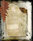 Old book with leaf, frame and splatters Royalty Free Stock Photography