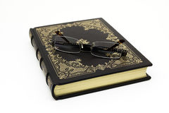 Old book. Old leather-bound book with glasses Royalty Free Stock Photos
