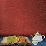 The old book with leaves and  teapot with  cup Royalty Free Stock Image