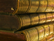 Old book in the light of candles Stock Photography