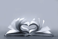 Old book. Love. Old book with overtuned sheets formed sign of heart Royalty Free Stock Photos