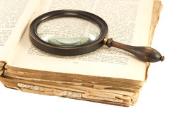 Old book and the magnifying glass Royalty Free Stock Images