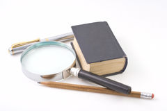 Old book and magnifying glass Royalty Free Stock Photo