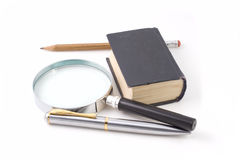 Old book and magnifying glass Royalty Free Stock Photography