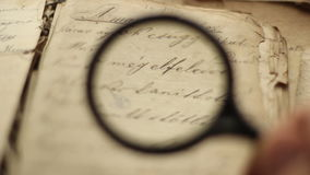 Old book and magnifying glass stock video