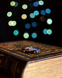 Old book and miniature car Royalty Free Stock Photos