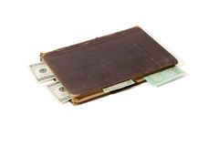 Old book with money bookmarks isolated Royalty Free Stock Photos