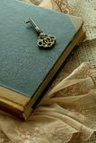 Old book and old key - retro composition Royalty Free Stock Photo