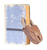 Old book with an old lock inserted through the pag Stock Photography
