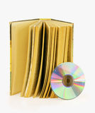 An old book and one compact disc. It is isolated on a white background Stock Image