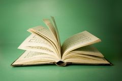 Old book, open. Musical notes on the inside pages Royalty Free Stock Images