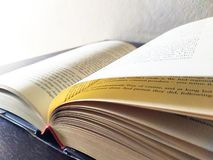 Book open on desk stock photography