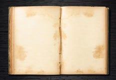 Old Book Open On Dark Wood Stock Photo